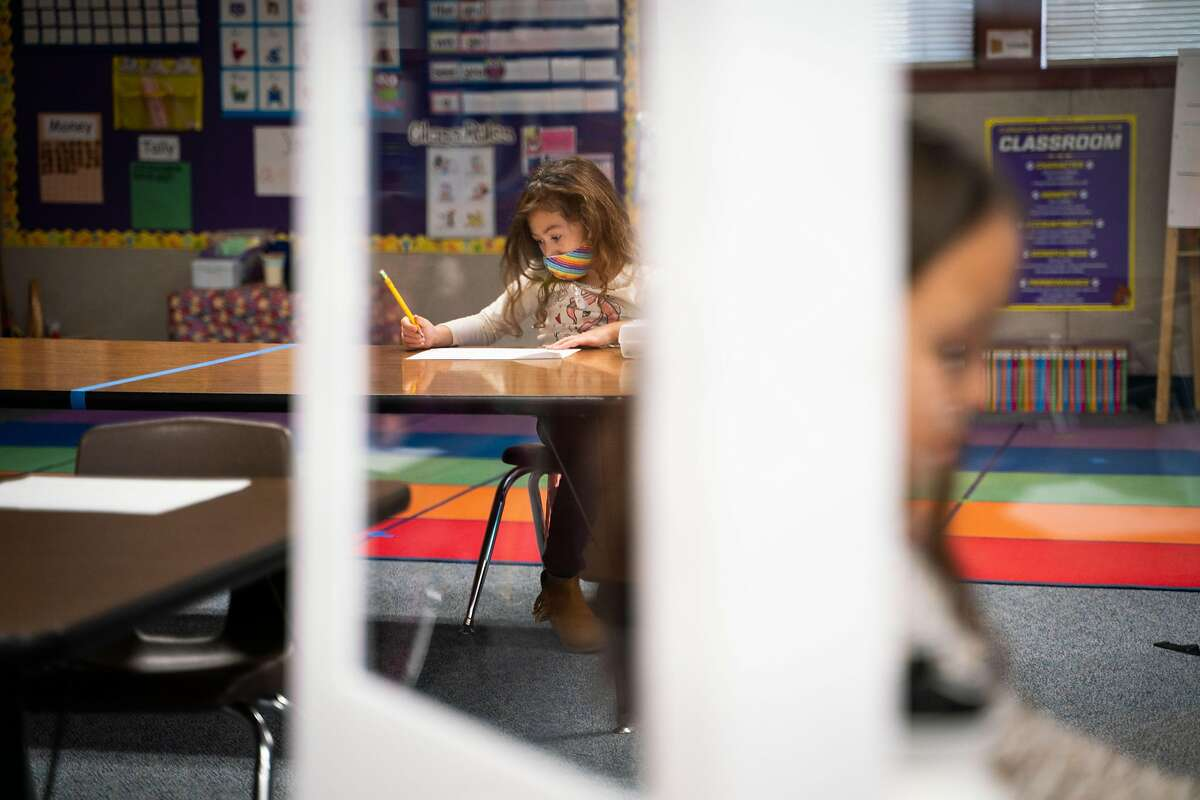 Kiera Perry sits socially distanced from other students in her kindergarten class in November at Manteca's Brock Elliott Elementary School in San Joaquin County.