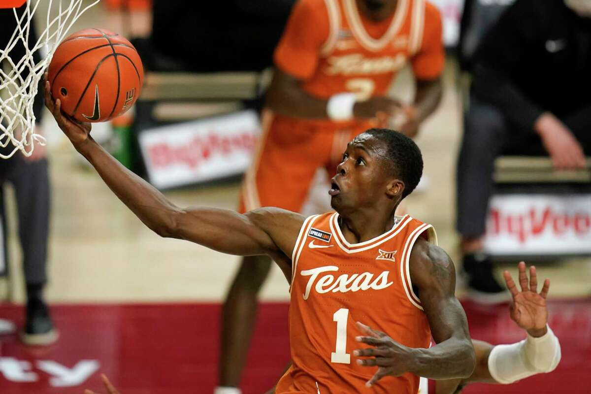 Texas guard Andrew Jones drives to the basket during the second half of an NCAA college basketball game against Iowa State, Tuesday, March 2, 2021, in Ames, Iowa. Texas won 81-67. (AP Photo/Charlie Neibergall)