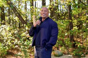 """Dwayne Johnson stars in """"Young Rock"""" on NBC."""