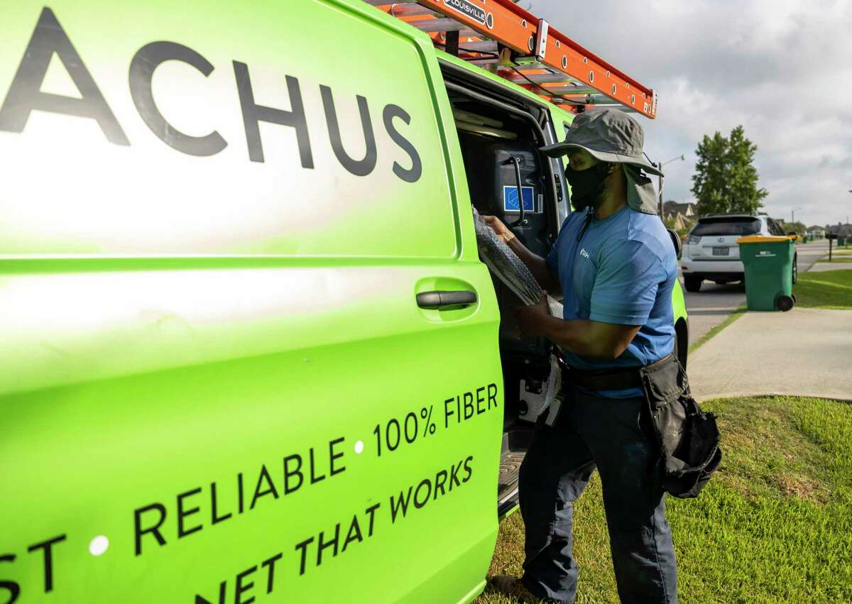 Darrell Nunn Jr., field service technician with Tachus Fiber Internet, unloads his work van in Eastern Lake Conroe in Panorama Village, Tuesday, July 14, 2020. John Langley was their first customer in the area and the company hopes to service more community members.