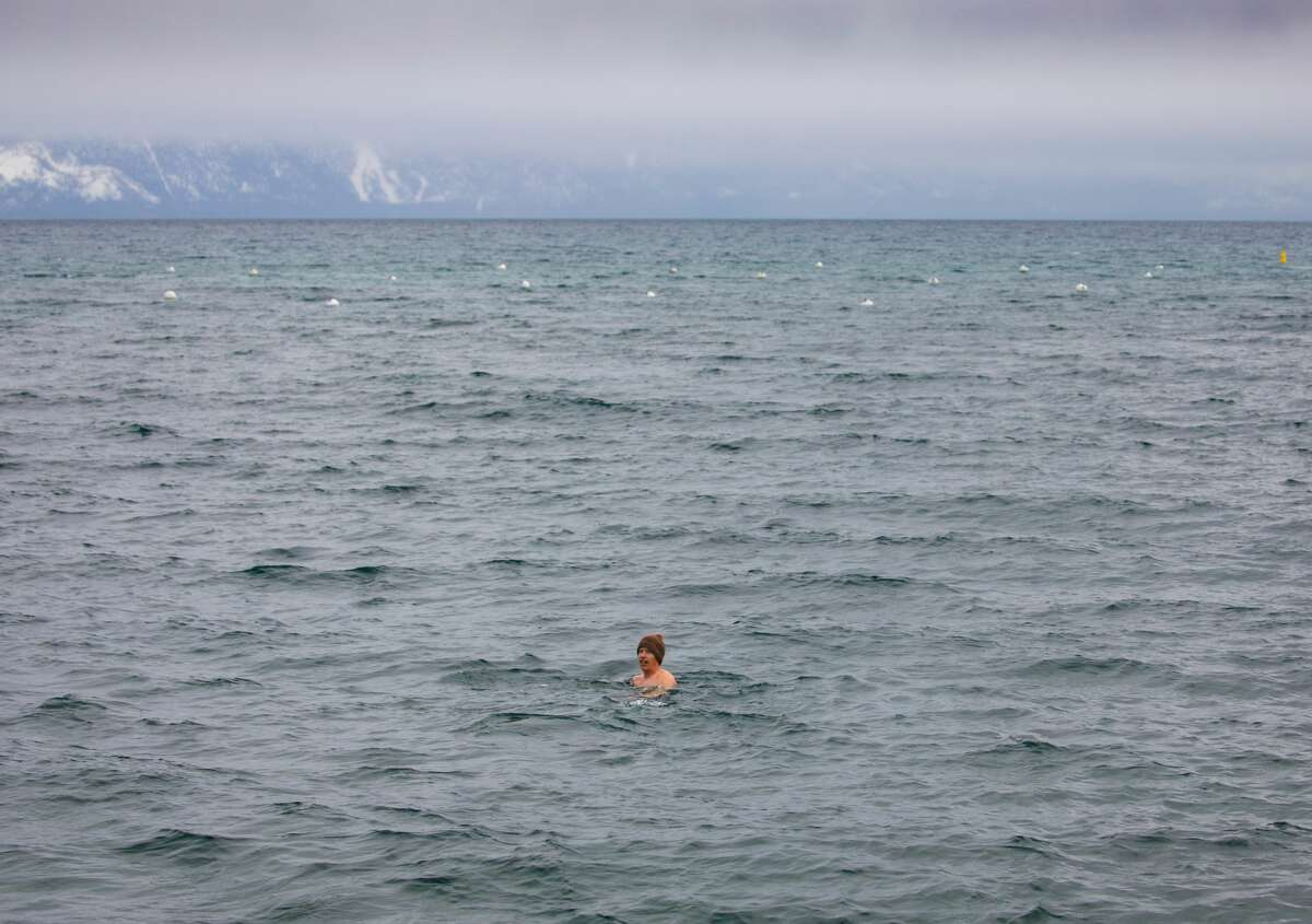 Nicholas Mitchell swims into the storm in Lake Tahoe. He is midway through a personal quest to swim for 365 consecutive days.