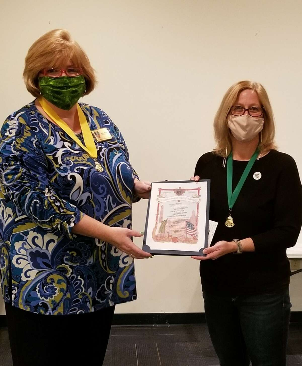 On March 10, the Ladies Ancient Order of Hibernians Schenectady JFK Division 1 celebrated its 120th anniversary. At a ceremony to mark this milestone, LAOH National President Karen Keane, left, presented Schenectady LAOH's president Kim DePeaux, right, with a proclamation. During the event, the LAOH also honored eight living past presidents from the Schenectady division as well as its deceased members.