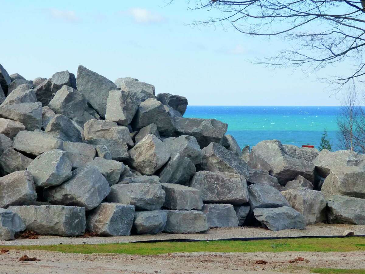 Boulders are piled along the Lake Michigan shore at Orchard Beach State Park. Park officials say the boulders will be used for a planned retaining wall. (File Photo)