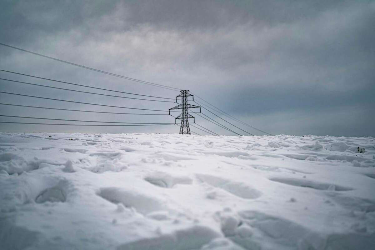 Power lines stretch across a snowy Dallas on Feb. 18. As weather patterns change, relying on past data when upgrading Texas power plants may not be sufficient.