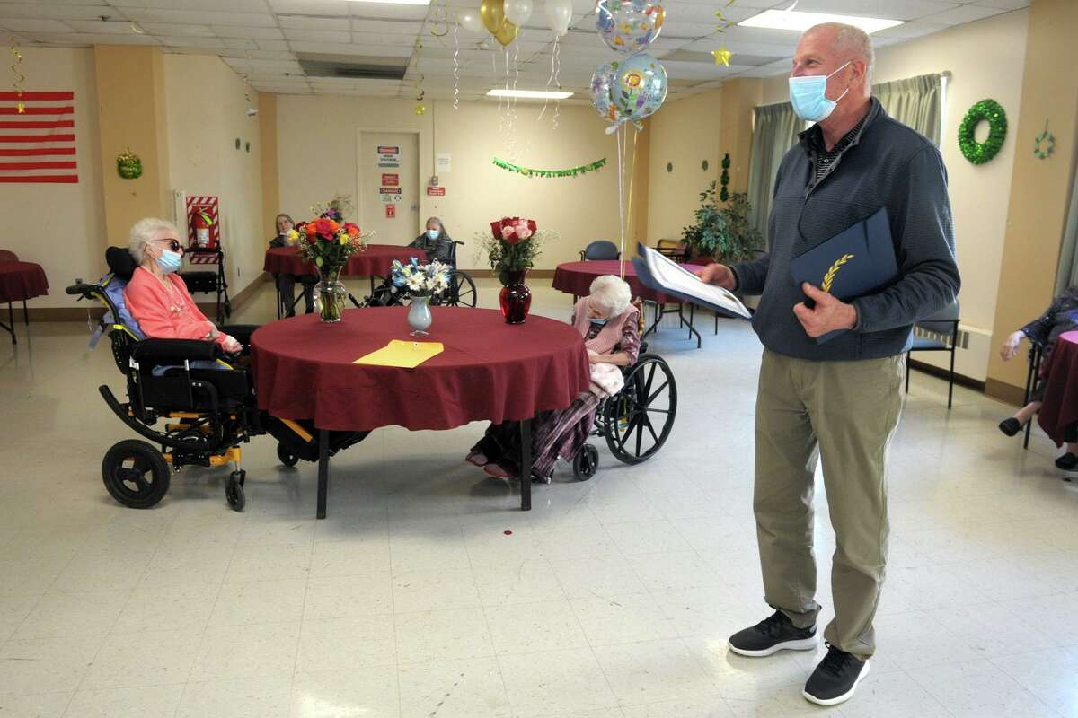 Mayor Mark Lauretti reads proclamations to Sophie Pollock, left, and Theresa Raccio during a birthday party at Hewitt Health and Rehabilitation Center, in Shelton, Conn. March 19, 2021. Pollock turned 102 this week, and Raccio turned 101.