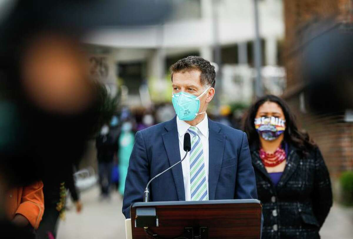 Dr. Grant Colfax, director of the San Francisco Department of Public Health, and Mayor London Breed at a news conference March 17. S.F. officials are worried about the delta variant spreading over the Fourth of July weekend.
