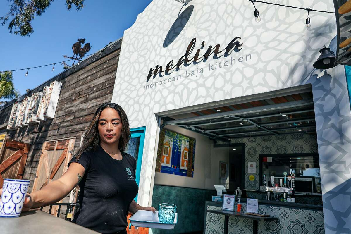 Alia Jaziri sets up her San Diego restaurant at the start of the day earlier this month. Jaziri is among the former Sharethrough employees who have refused to sign off on the merger