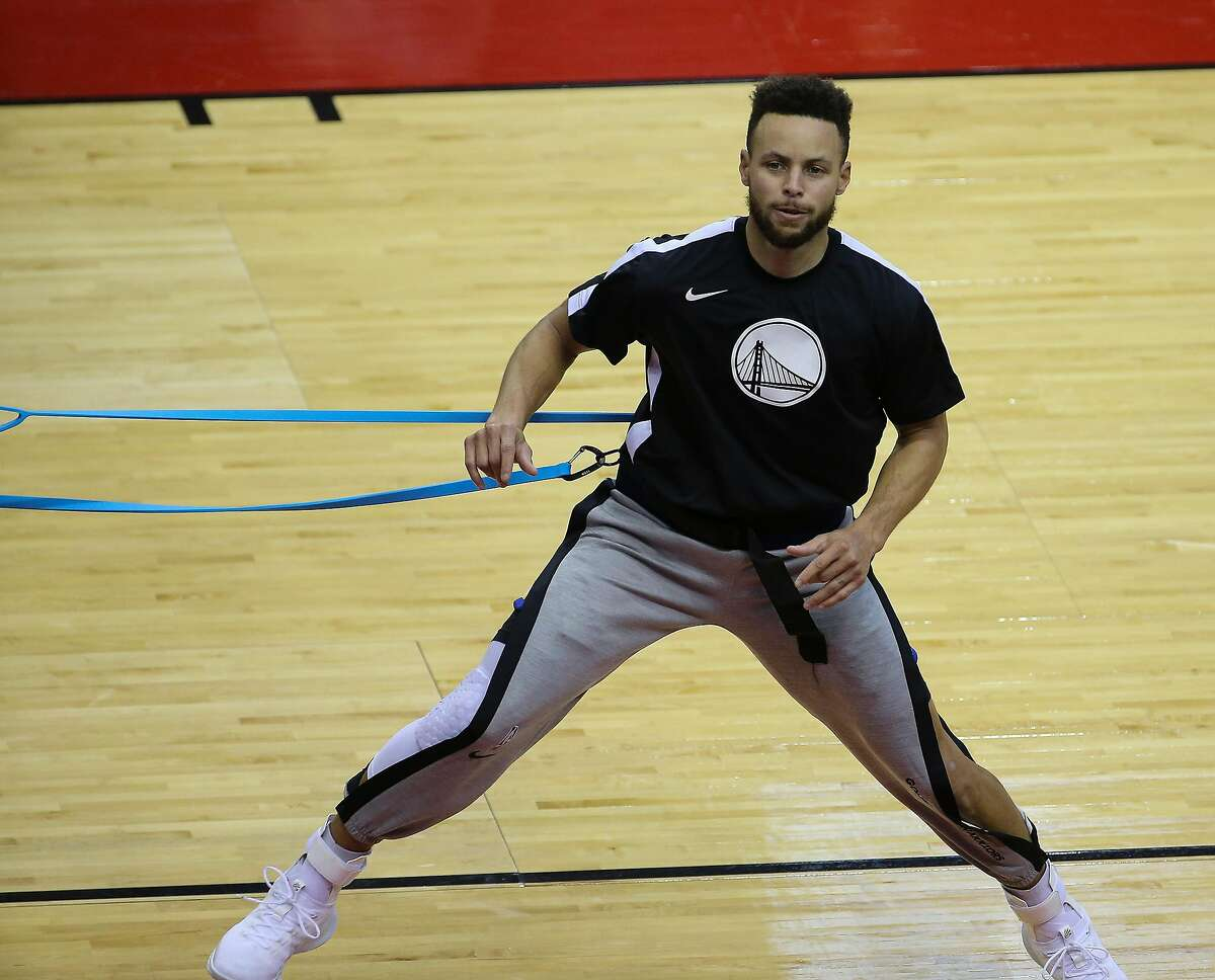 Golden State Warriors guard Stephen Curry (30) warms up before the NBA game against the Houston Rockets Wednesday, March 17, 2021, at Toyota Center in Houston.