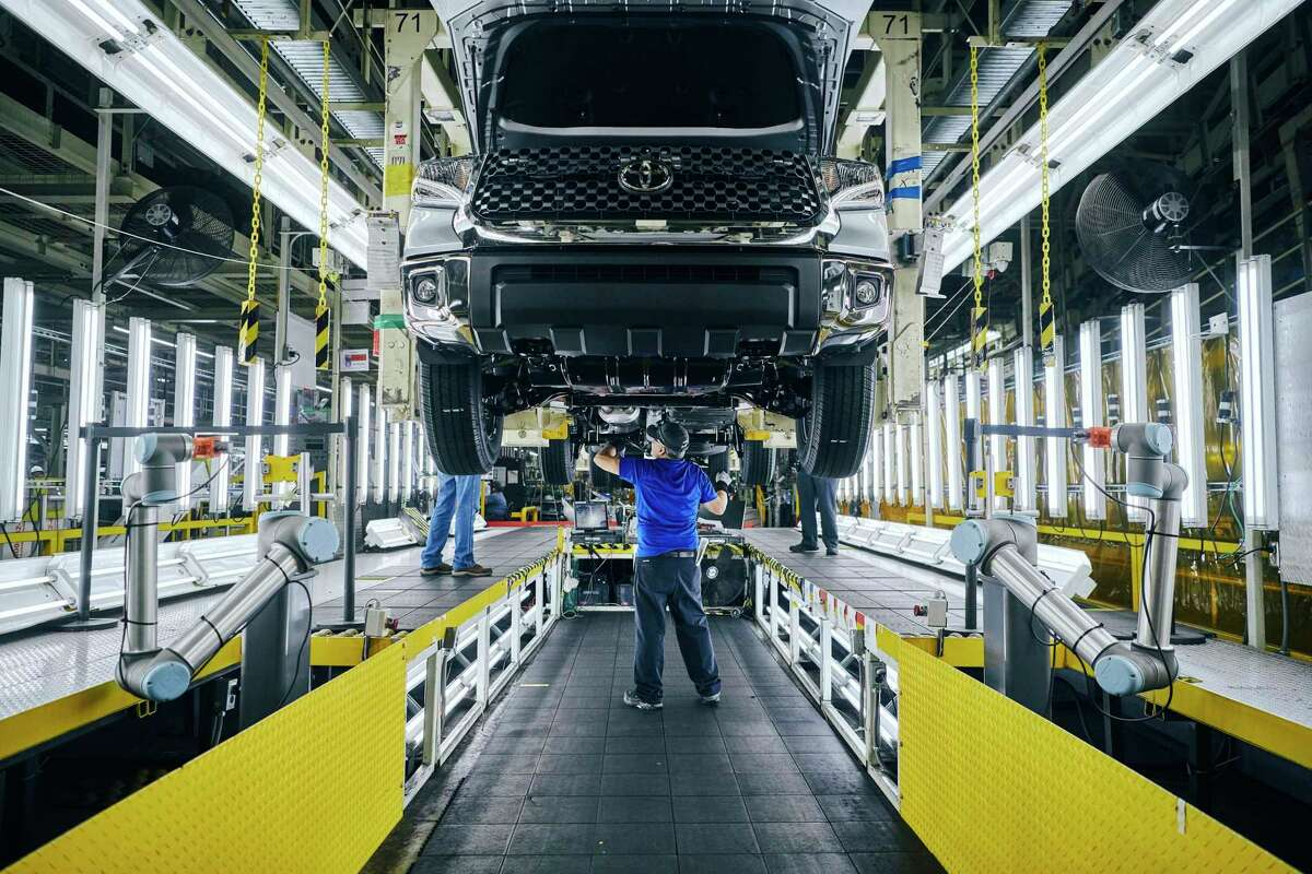 Employees work on the assembly lines at Toyota's manufacturing plant in San Antonio, Texas in this file photo. Severe weather, port blockages and microchip shortages are wreaking havoc on U.S. auto production with Toyota Motor Corp. and Honda Motor Co. Ltd. now facing disruptions. (Toyota Texas/TNS)