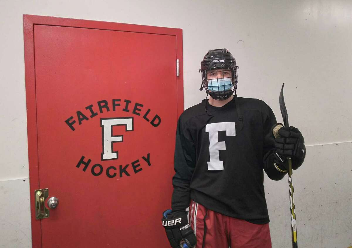 Defenseman Sam Swanson, outside the team's dressing room at the Wonderland of Ice in Bridgeport, Conn., has helped the Fairfield co-op boys hockey team to one of the best seasons in program history in 2021.