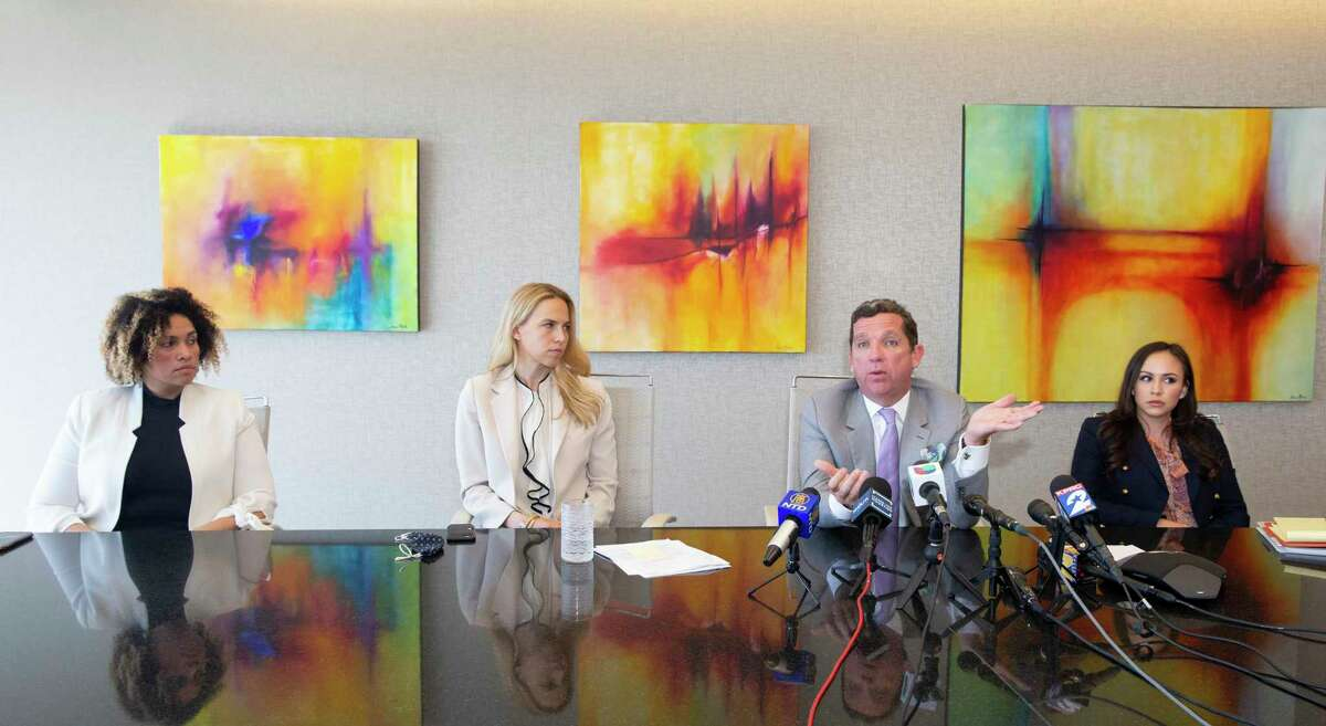 Attorney Tony Buzbee says his firm will file total of 12 civil cases against Houston Texans quarterback Deshaun Watson, accusing him of sexual assault, Friday, March 19, 2021 in Houston. Buzbee said seven cases have been filed and five more will be filed soon. Three of his associates, Maria Elena Holmes, from left, Cornelia Brandfield-Harvey and Crystal Del Toro will be on the team for these cases.