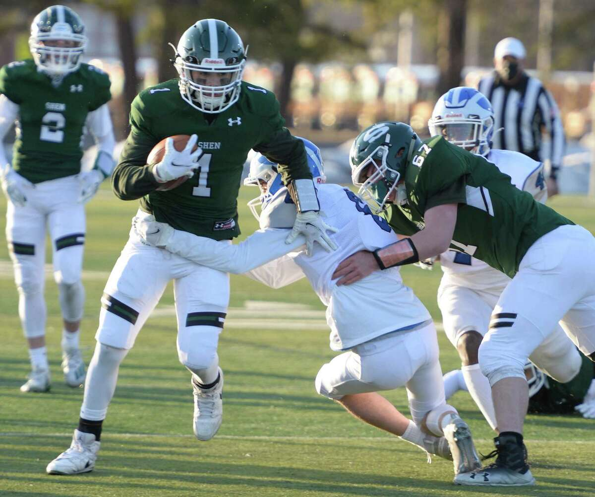 Shen offensive lineman Aidan Ritter breaks a tackle of quarterback Brody Vincenzi by Shaker defensive back Matthew Calicchia during a game Friday, Mar. 19, 2021, in Clifton Park, N.Y. (Jenn March, Special to the Times Union )