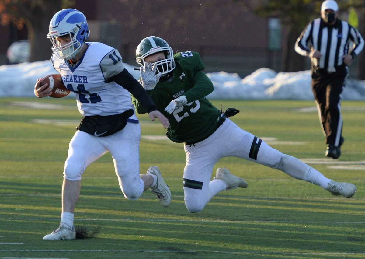 Shen linebacker Nick Bagramian attempts to tackle Shaker quarterback Joey Mirabile as he runs the ball during a game Friday, Mar. 19, 2021, in Clifton Park, N.Y. (Jenn March, Special to the Times Union )