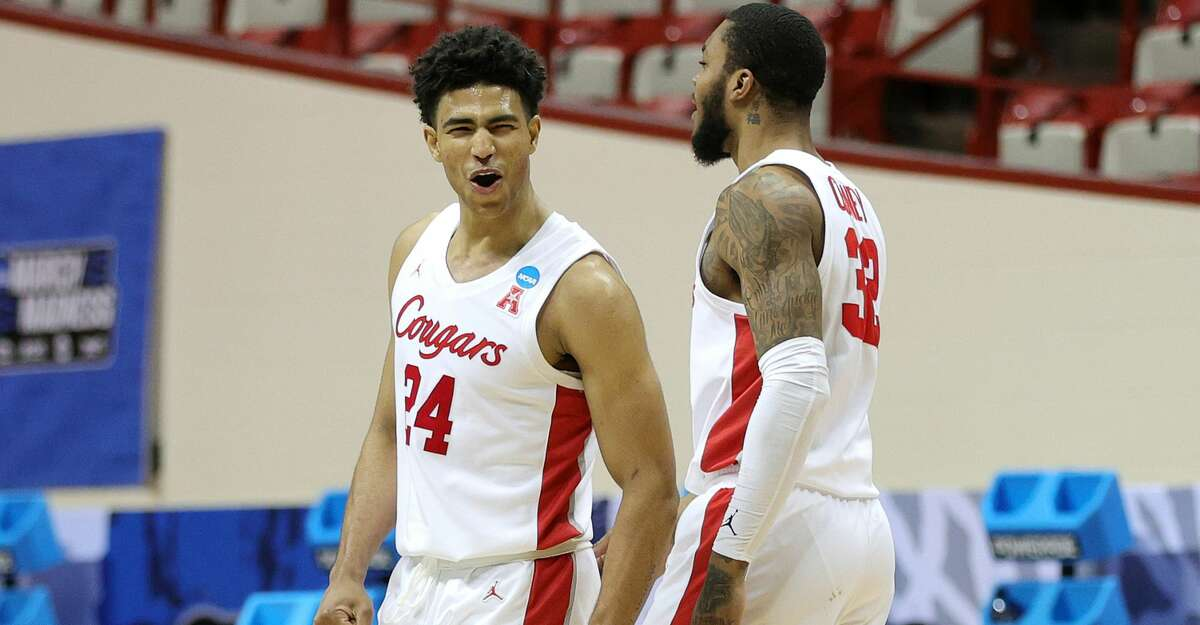 Quentin Grimes #24 of the Houston Cougars reacts after making a three point basket during the second half against the Cleveland State Vikings in the first round game of the 2021 NCAA Men's Basketball Tournament at Assembly Hall on March 19, 2021 in Bloomington, Indiana. (Photo by Stacy Revere/Getty Images)