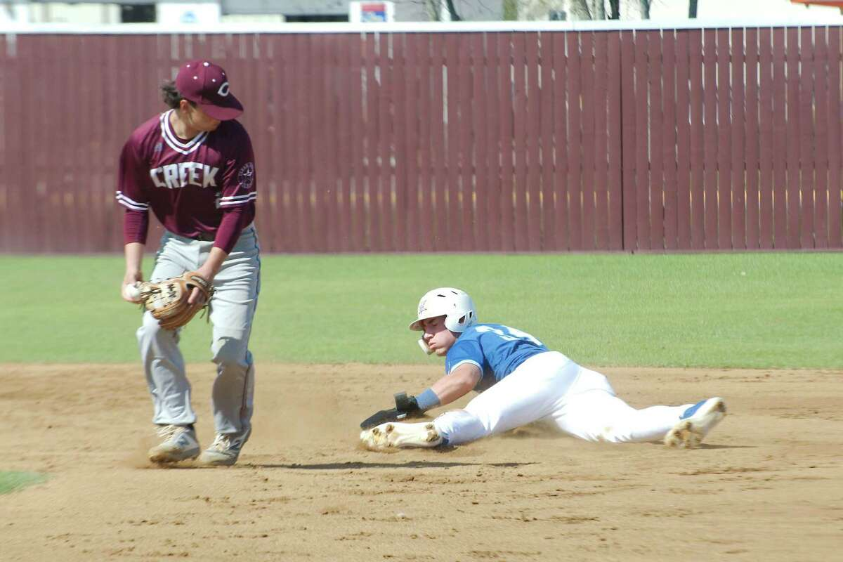 Friendswood's Izaac Pacheco, shown sliding into second base in a non-district game, blasted a home run in helping the state-ranked Mustangs remain unbeaten Friday night.