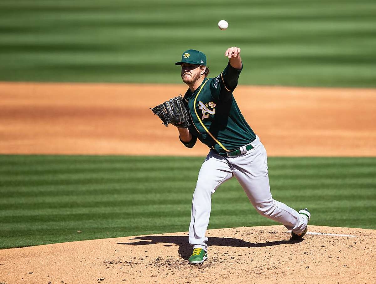 SCOTTSDALE, AZ - MARCH 03: Cole Irvin #71of the Oakland Athletics pitches during a spring training game against the Colorado Rockies at Salt River Field on March 3, 2021 in Scottsdale, Arizona. (Photo by Rob Tringali/Getty Images)