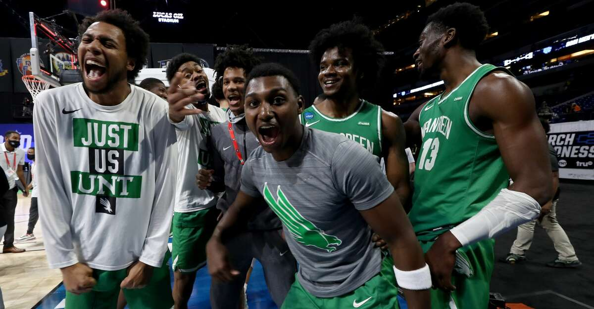The North Texas Mean Green celebrate after beating the Purdue Boilermakers 78-69 in overtime in the first round game of the 2021 NCAA Men's Basketball Tournament at Lucas Oil Stadium on March 19, 2021 in Indianapolis, Indiana. (Photo by Jamie Squire/Getty Images)