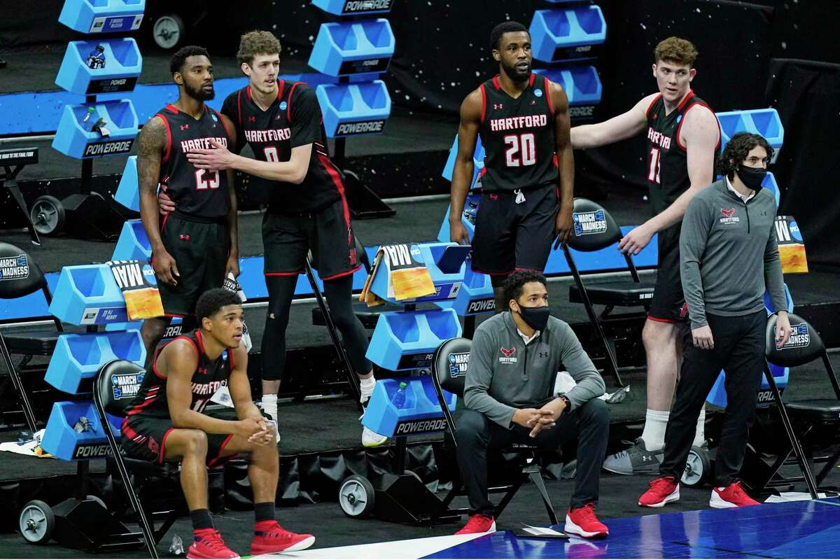 Hartford players watch the final moments of their loss to Baylor during a college basketball game in the first round of the NCAA tournament at Lucas Oil Stadium in Indianapolis Friday, March 19, 2021, in Indianapolis, Tenn. (AP Photo/Mark Humphrey)