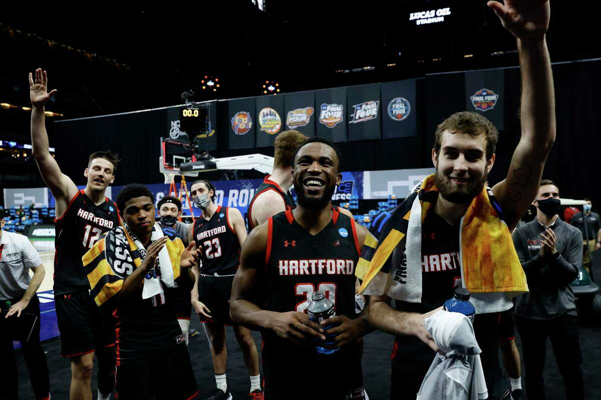 Hartford players wave to fans in attendance following their first-round loss to Baylor in the NCAA Tournament on March 19 in in Indianapolis. It was the first time the Hawks advanced to the Division I NCAA Tournament in school history.