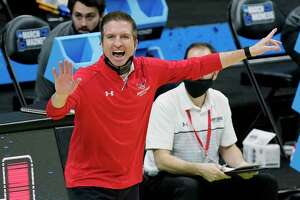 Hartford head coach John Gallagher yells to his players during the first half of a college basketball game against Baylor in the first round of the NCAA tournament at Lucas Oil Stadium in Indianapolis Friday, March 19, 2021, in Indianapolis, Tenn. (AP Photo/Mark Humphrey)