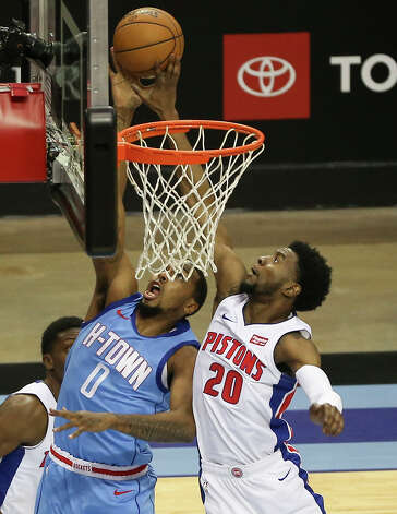 Detroit Pistons guard Josh Jackson (20) blocks Houston Rockets forward Sterling Brown (0) during the third quarter of the NBA game Friday, March 19, 2021, at Toyota Center in Houston. Photo: Yi-Chin Lee/Staff Photographer / © 2021 Houston Chronicle