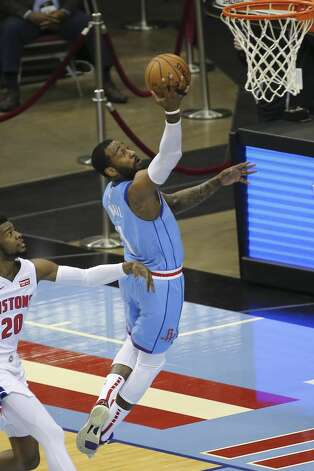 Houston Rockets guard John Wall (1) goes for a lay up while Detroit Pistons guard Josh Jackson (20) watches on during the first quarter of the NBA game Friday, March 19, 2021, at Toyota Center in Houston. Photo: Yi-Chin Lee/Staff Photographer / © 2021 Houston Chronicle