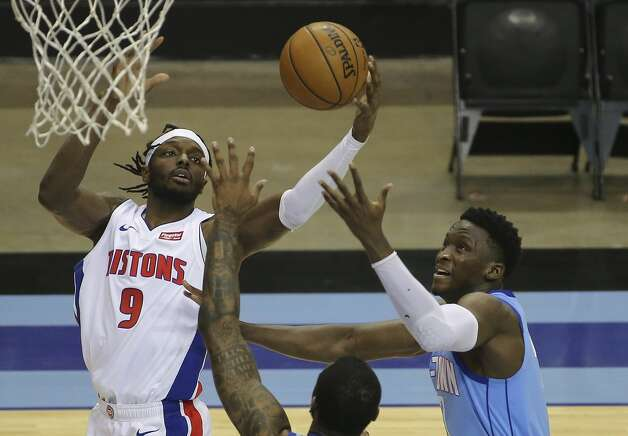 Houston Rockets guard Victor Oladipo (7) hopes to grab the ball that slipped out of Detroit Pistons forward Jerami Grant's (9) hand during the second quarter of the NBA game Friday, March 19, 2021, at Toyota Center in Houston. Photo: Yi-Chin Lee/Staff Photographer / © 2021 Houston Chronicle
