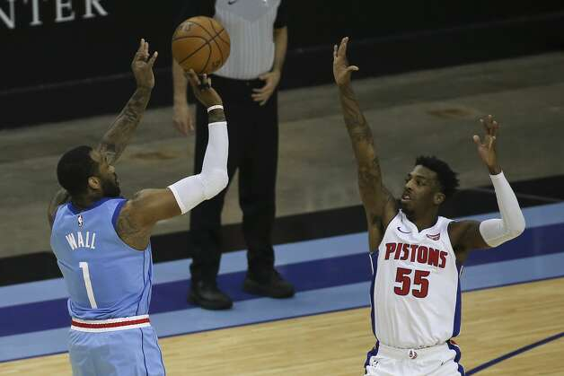 Houston Rockets guard John Wall (1) scores a three point basket over Detroit Pistons guard Delon Wright (55) during the second quarter of the NBA game Friday, March 19, 2021, at Toyota Center in Houston. Photo: Yi-Chin Lee/Staff Photographer / © 2021 Houston Chronicle