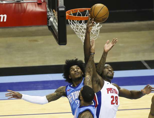 Houston Rockets forward Sterling Brown, bottom, fouls on Detroit Pistons center Isaiah Stewart (28) while they go to grab a rebound during the second quarter of the NBA game Friday, March 19, 2021, at Toyota Center in Houston. Photo: Yi-Chin Lee/Staff Photographer / © 2021 Houston Chronicle