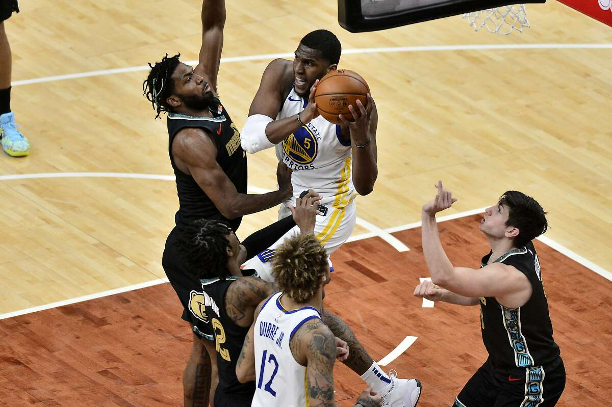 Golden State Warriors center Kevon Looney (5) handles the ball next to Memphis Grizzlies forward Justise Winslow, left, during the second half of an NBA basketball game Friday, March 19, 2021, in Memphis, Tenn. (AP Photo/Brandon Dill)