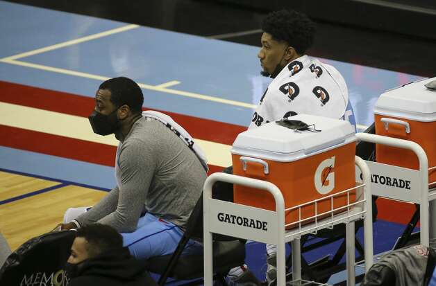Houston Rockets guard John Wall, left, and center Christian Wood watch the fourth quarter of the NBA game against the Detroit Pistons from the bench Friday, March 19, 2021, at Toyota Center in Houston. Photo: Yi-Chin Lee/Staff Photographer / © 2021 Houston Chronicle