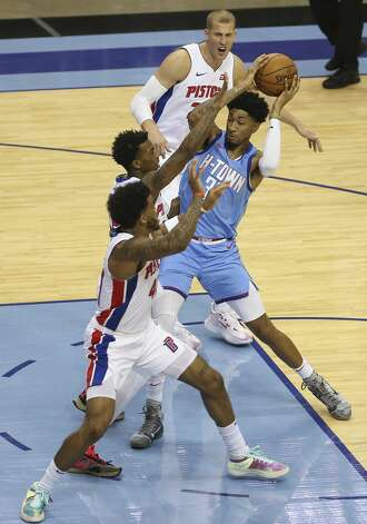 Houston Rockets center Christian Wood (35) is defensed by Detroit Pistons players during the third quarter of the NBA game Friday, March 19, 2021, at Toyota Center in Houston. Photo: Yi-Chin Lee/Staff Photographer / © 2021 Houston Chronicle