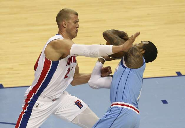 Detroit Pistons center Mason Plumlee (24) fouls on Houston Rockets guard John Wall (1) during the third quarter of the NBA game Friday, March 19, 2021, at Toyota Center in Houston. Photo: Yi-Chin Lee/Staff Photographer / © 2021 Houston Chronicle