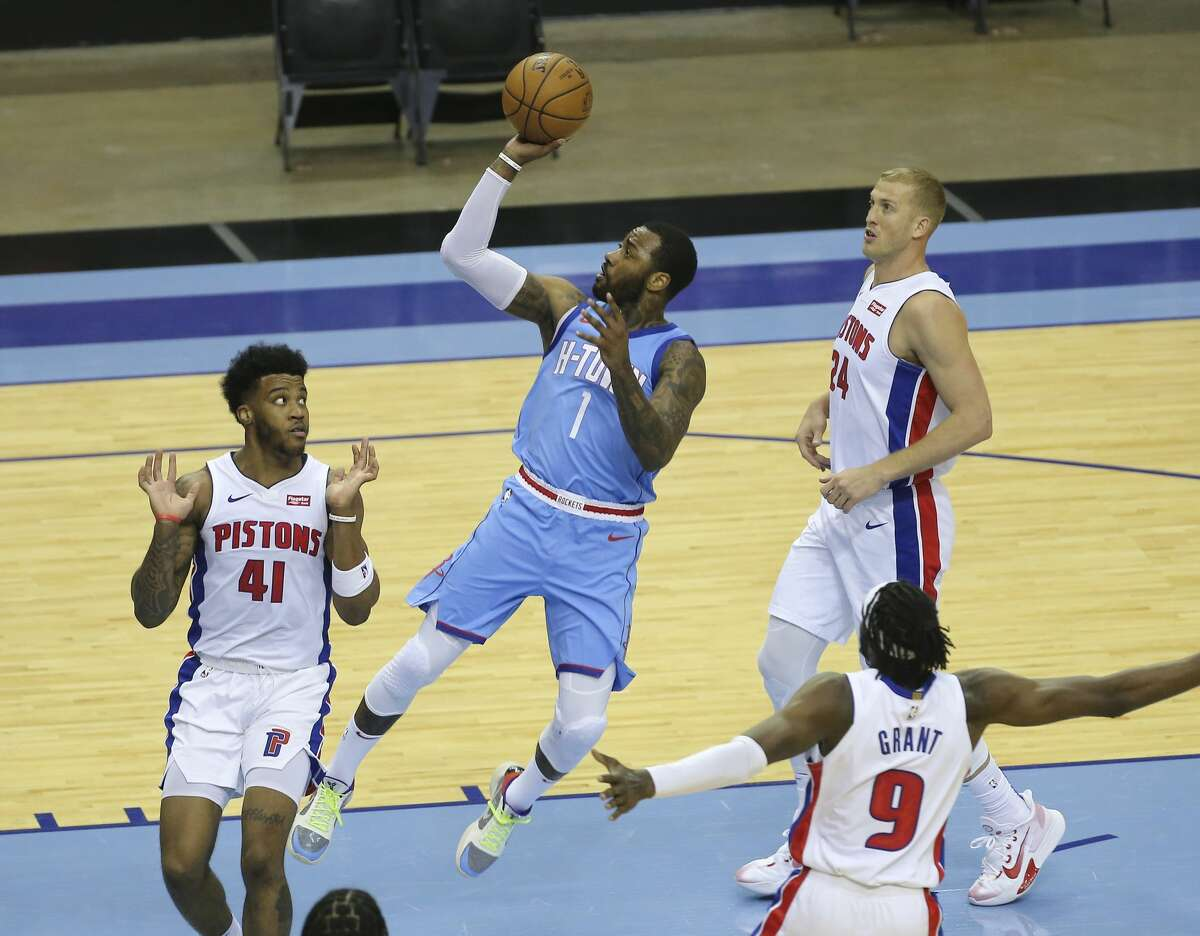 Houston Rockets guard John Wall (1) takes a shot during the third quarter of the NBA game against the Detroit Pistons Friday, March 19, 2021, at Toyota Center in Houston.