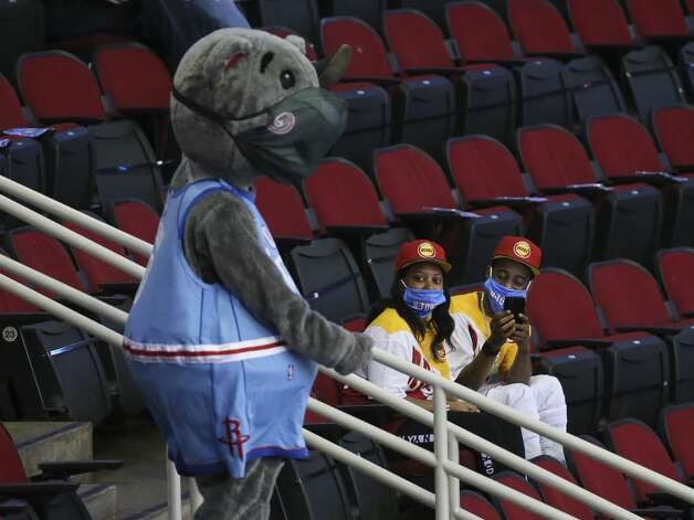 A Houston Rockets fan take pictures of mascot Clutch with his cellphone during the first quarter of the NBA game against the Detroit Pistons Friday, March 19, 2021, at Toyota Center in Houston. Photo: Yi-Chin Lee/Staff Photographer / © 2021 Houston Chronicle