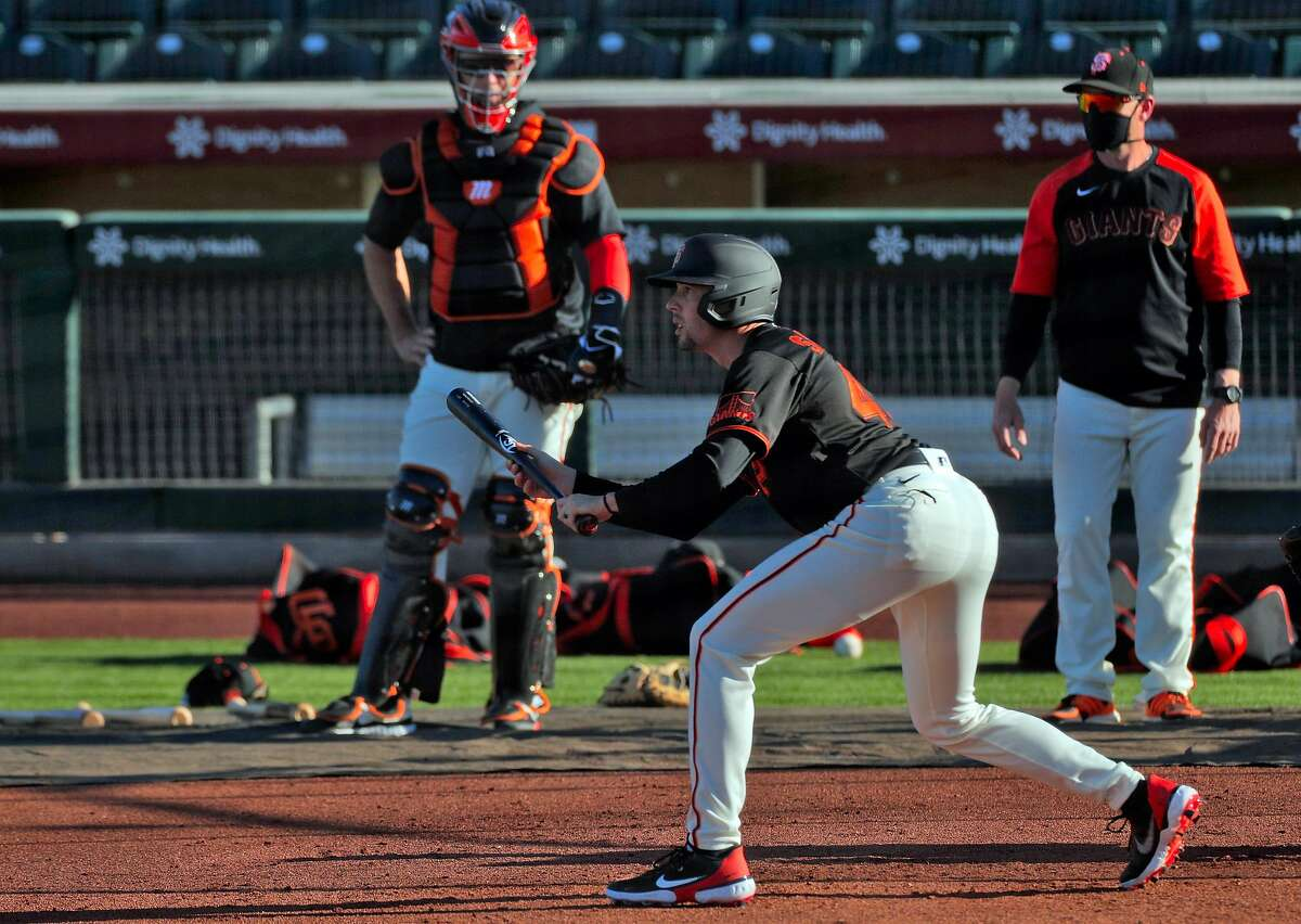Aaron Sanchez (48) practices bunting as the San Francisco Giants worked out at Scottsdale Stadium in Scottsdale, Ariz., on Tuesday, March 2, 2021.
