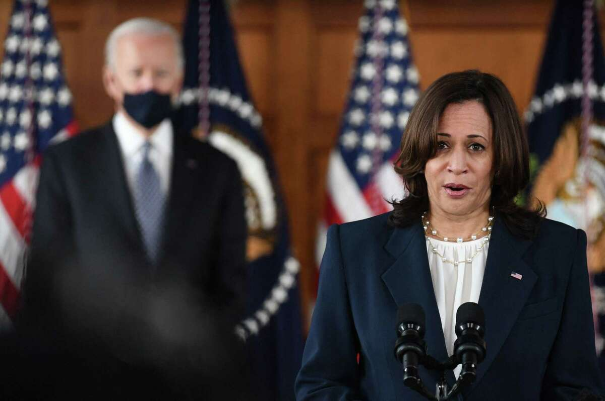 US Vice President Kamala Harris speaks as US President Joe Biden looks on during a listening session with Georgia Asian American and Pacific Islander community leaders at Emory University in Atlanta, Georgia on March 19, 2021.
