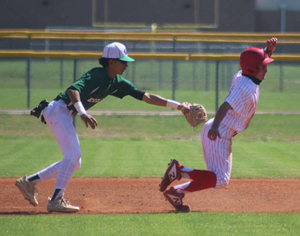 South Houston's Rick Gallego is unable to survive a rundown between first and second base during Friday afternoon's 22-6A game. as the Eagles apply the tag.