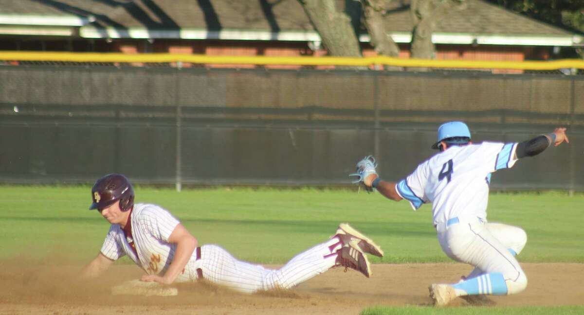 Deer Park's Jayden Miller slides into second base, avoiding the tag of Rayburn's second baseman. Miller's steal started the avalanche of eight runs in the second inning, not to mention the 14 batters that paraded to the plate.