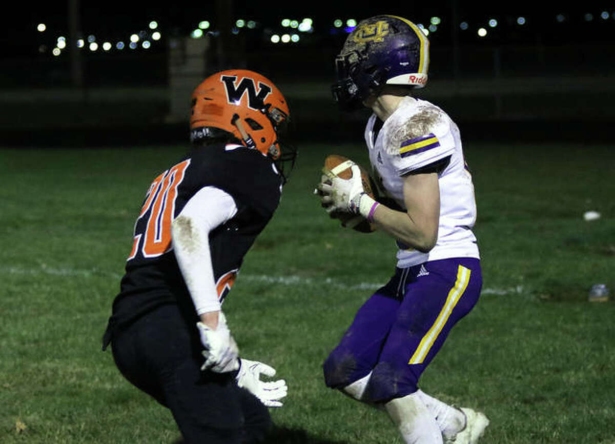 CM receiver Luke Parmentier backs into the end zone for a 20-yard TD reception after getting behind Waterloo DB Adron Winget in the fourth quarter Friday night in Waterloo.