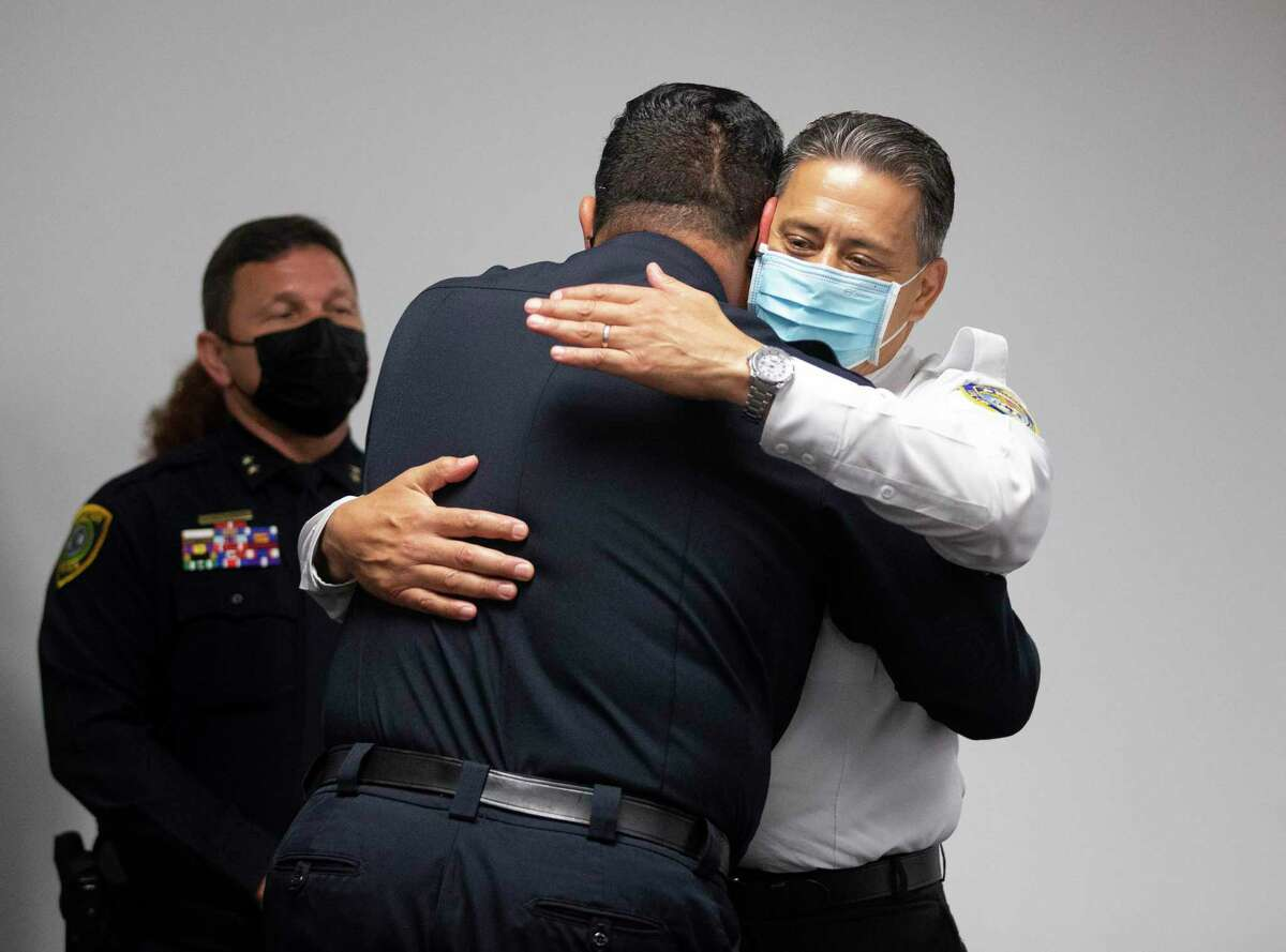 Houston Police Chief Art Acevedo hugs Houston Fire Chief Sam Peña at press conference on Tuesday, March 16, 2021, in Houston.