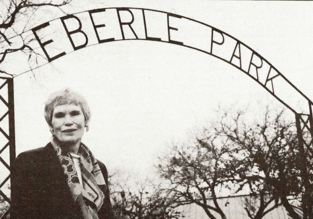 Marie Eberle stands in front of the entrance to Eberle Park at Randolph AFB (now Joint Base San Antonio-Randolph) in 1995. The park is named for her husband, Capt. Joseph N. Eberle, 27, a World War II veteran who was killed in a 1953 crash at Randolph AFB. Eberle was declared a hero because he opted to stay with his plane to divert it away from base housing instead of ejecting.