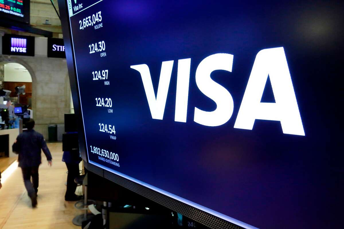 Visa is under investigation by the U.S. Justice Department's antitrust division over whether the company pushes merchants into more expensive forms of debit card payments, according to a report.