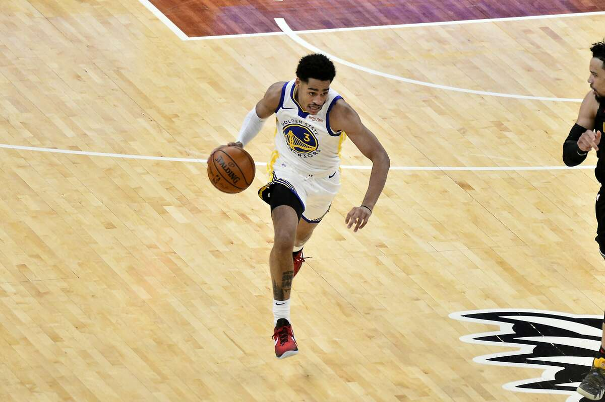 Golden State Warriors guard Jordan Poole (3) handles the ball in the second half of an NBA basketball game against the Memphis Grizzlies Friday, March 19, 2021, in Memphis, Tenn. (AP Photo/Brandon Dill)