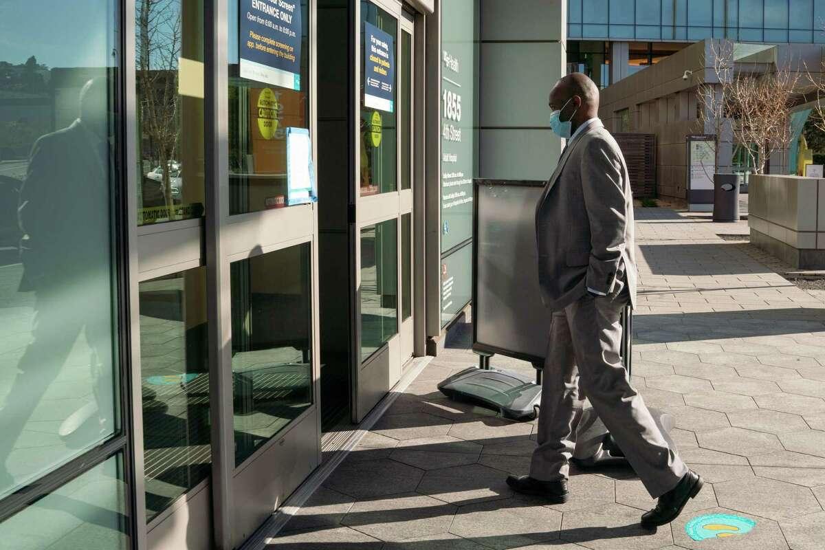 Dr. Anthony Muiru enters UCSF Medical Center at Mission Bay.