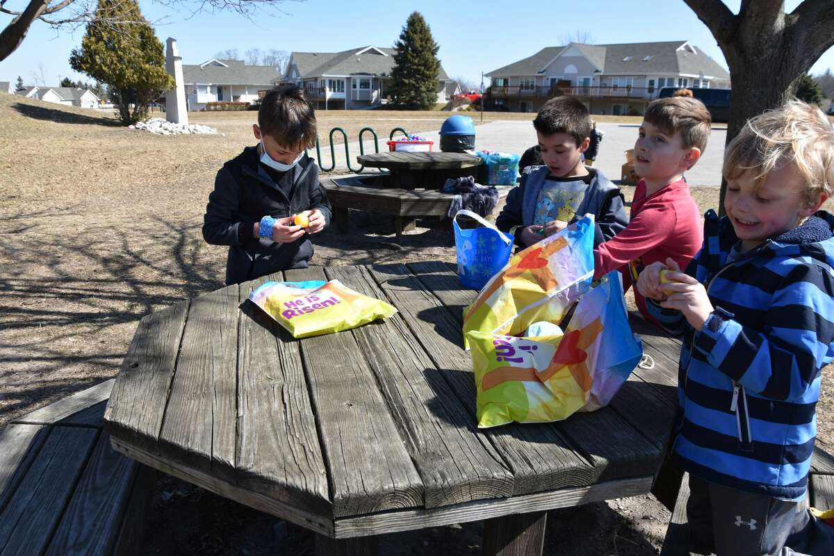 After gathering the eggs, children had a chance to open the eggs at picnic tables or in the sunshine with their families.