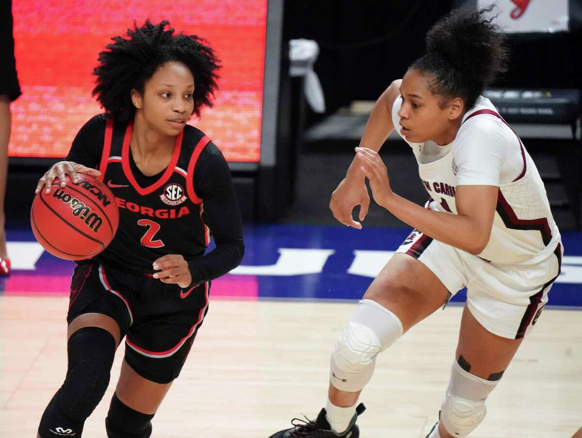 Georgia guard Gabby Connally (2) dribbles next to South Carolina guard Zia Cooke (1) during the second half of an NCAA college basketball game Sunday, March 7, 2021, during the Southeastern Conference tournament final in Greenville, S.C. South Carolina won 67-62.
