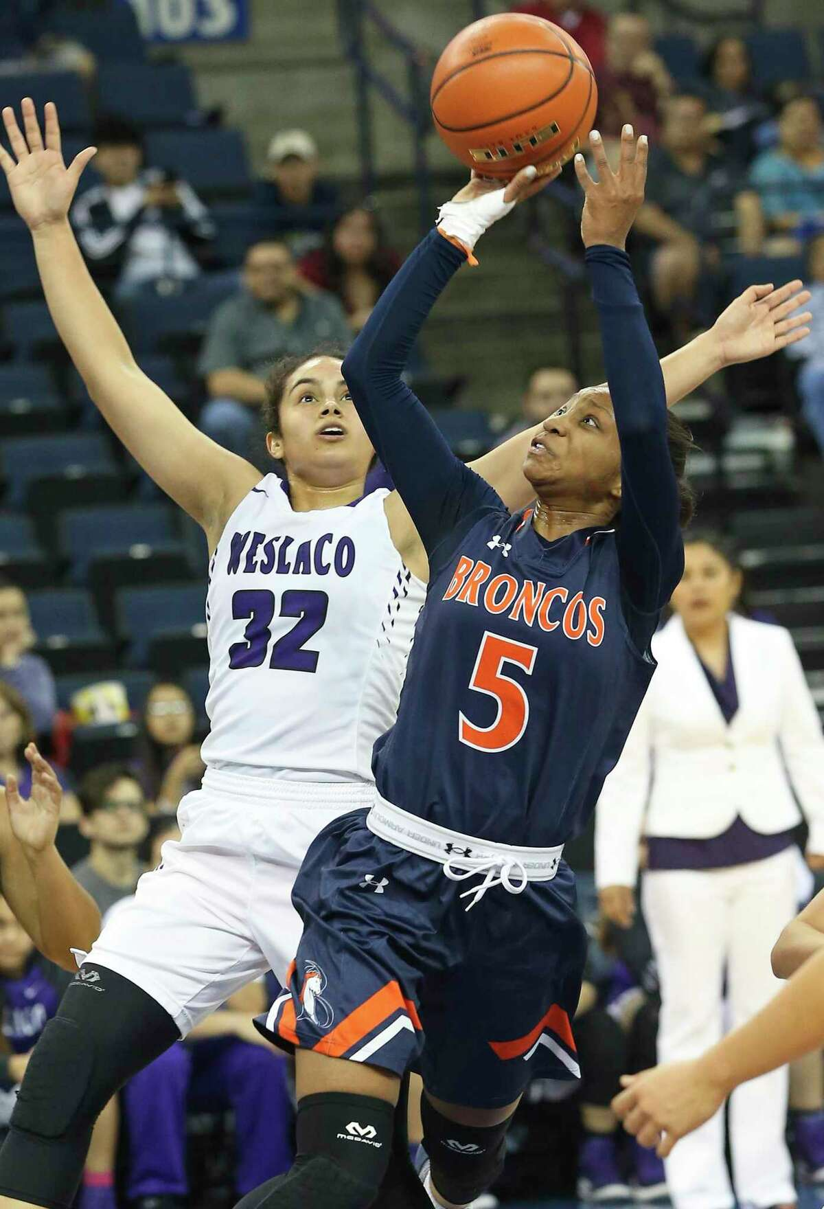 Bronco guard Gabby Connally shoots at the hoop after beating Andrea Villegas as Brandeis plays Weslaco at the Laredo Energy Arena in the Region IV-6A semifinals of girls basketball on February 24, 2017.