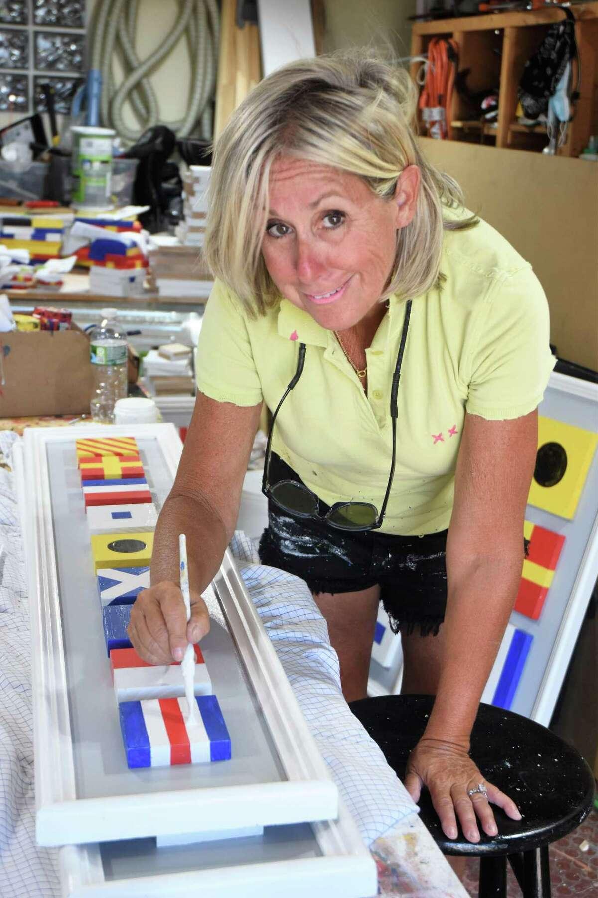 Pam Hadden Tomlin working in her garage studio.