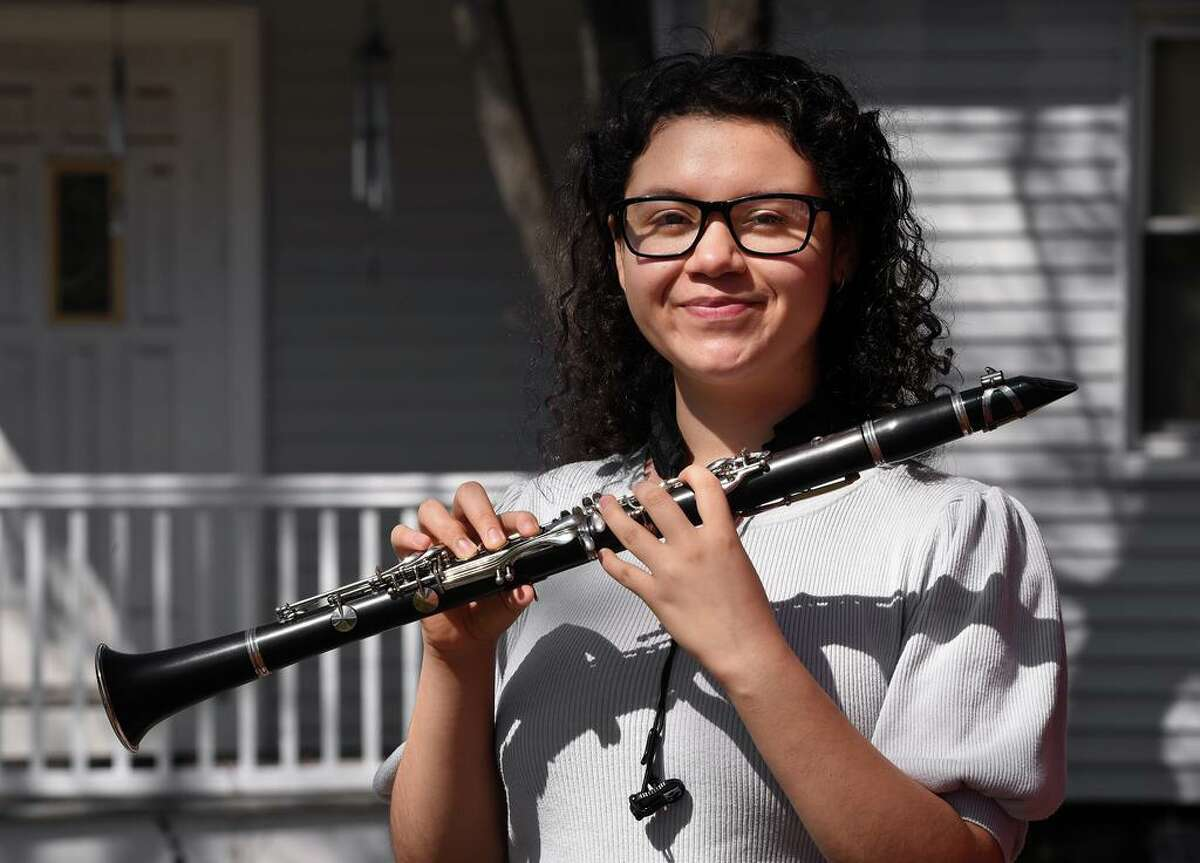 Cooperative Arts and Humanities High School senior and clarinetist in the band, Kiana Flores, 17, is photographed at her home in New Haven on March 20, 2021.